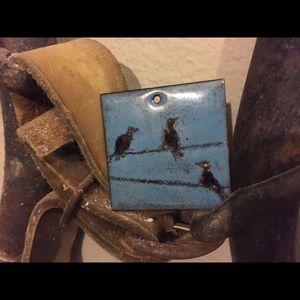 Crow on wire enamel pendant